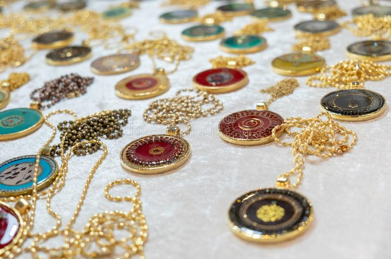Medallions or pendants for sale at handicraft market royalty free stock photos
