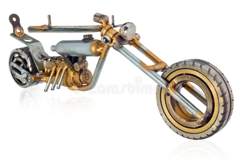 Handmade miniature of a chopper motorcycle. Decorative vehicle made of mechanical parts, bearings, wires, car candles, screws, pla royalty free stock photos