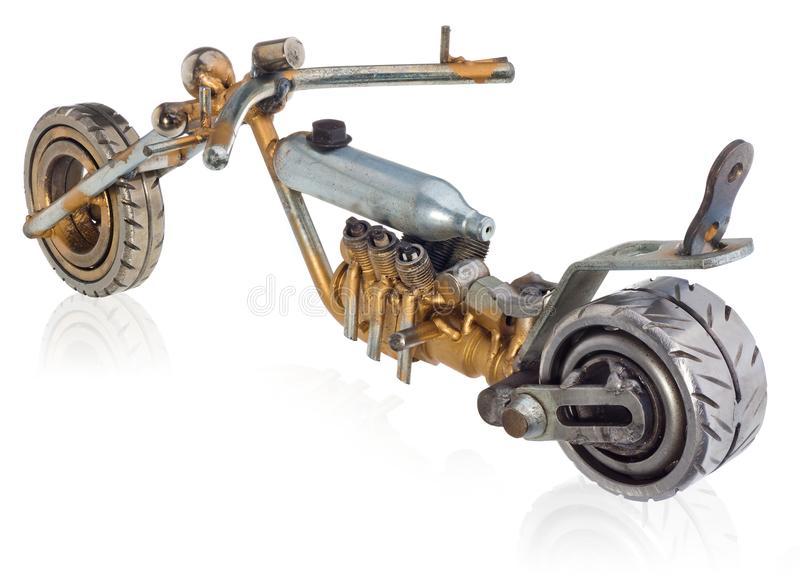 Handmade miniature of a chopper motorcycle. Decorative vehicle made of mechanical parts, bearings, wires, car candles, screws, pla stock image