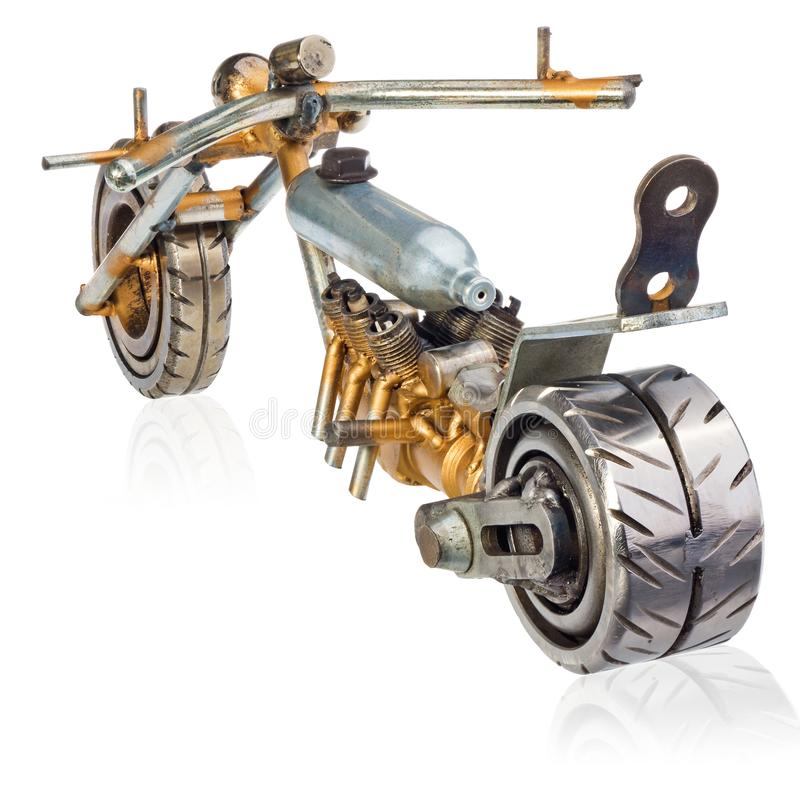 Handmade miniature of a chopper motorcycle. Decorative vehicle made of mechanical parts, bearings, wires, car candles, screws, pla stock photo
