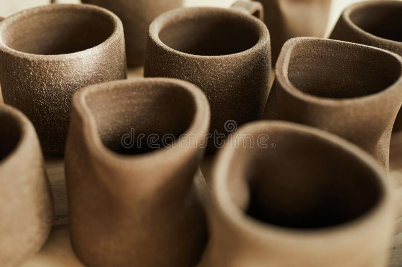 Handmade Mugs in Pottery Shop. Closeup of handmade ceramic mugs in pottery shop, copy space royalty free stock images
