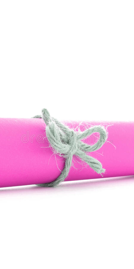 Handmade natural cord node tied on pink paper tube isolated stock images