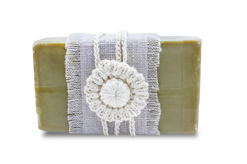 Handmade, natural organic olive oil soap isolated on white. Spa bath accessories, feminine care products. Hygiene concept photo. H. Erbal vaginal soap bar with stock image