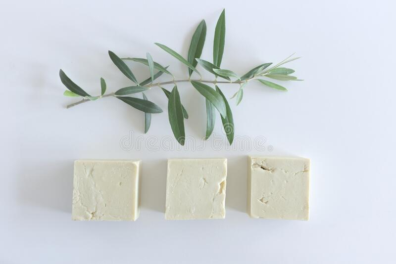 Handmade, natural organic olive oil soap and olive leave isolated on white. Spa, feminine care products. Hygiene concept. Handmade, natural organic olive oil royalty free stock photography