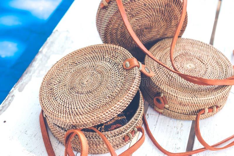 Handmade natural organic rattan handbag. Tropical island of Bali. Eco-bag concept. Ecobags from Bali. Handmade natural organic rattan handbag. Stylish bag stock photo