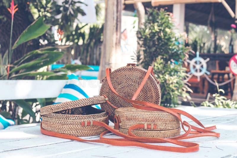 Handmade natural organic rattan handbag. Tropical island of Bali. Eco-bag concept. Ecobags from Bali. Handmade natural organic rattan handbag. Stylish bag stock photography
