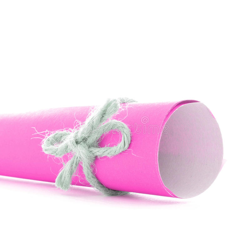 Handmade natural string bow tied on pink paper roll isolated stock images