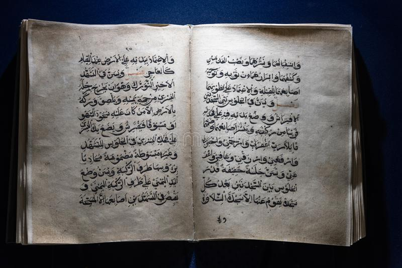 The Handmade old quran open for reading stock image