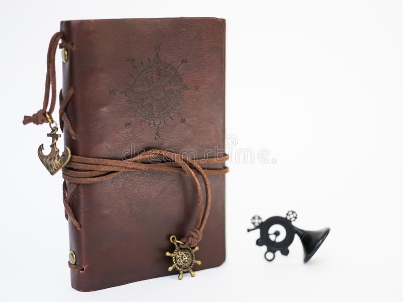 Handmade paper diary notebook in brown leather cover with over white background stock photography