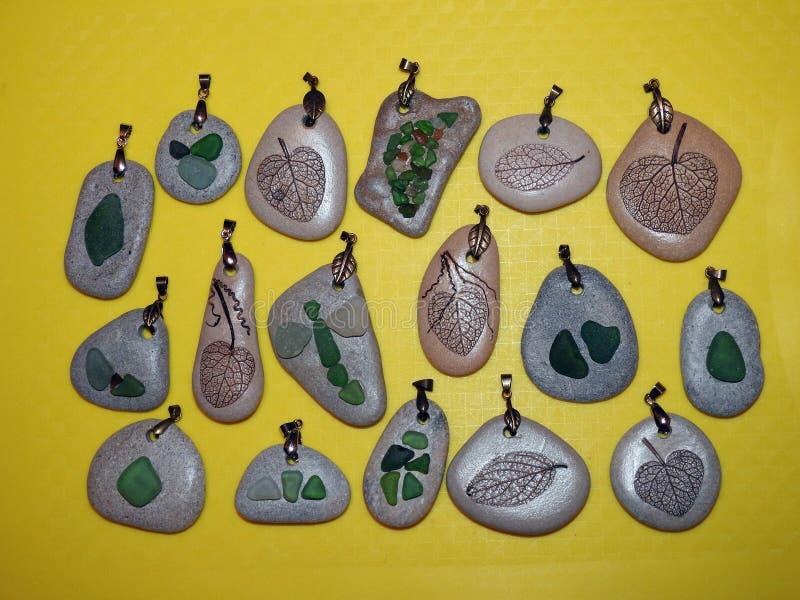 Handmade pendant using sea glass, sea stone and leaf skeleton, Lithuania stock photos