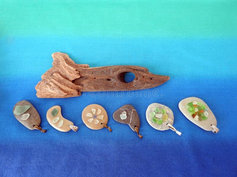 Handmade pendants nd fish using sea glass and sea stone , Lithuania royalty free stock photos