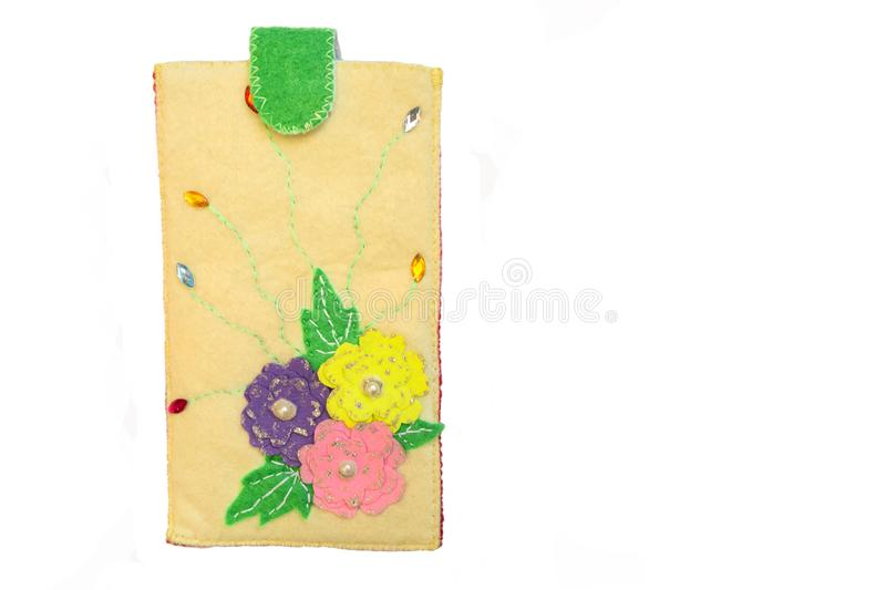 Handmade phone case made of felt. With colorful fabric flowers stock image