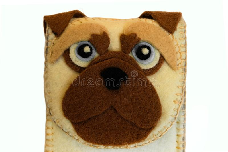 Handmade phone case made of felt with dog face. Fictional character close-up royalty free stock photo