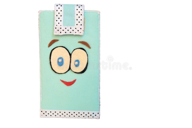 Handmade phone case made of felt. Fictional character - face with big eyes and smile royalty free stock images