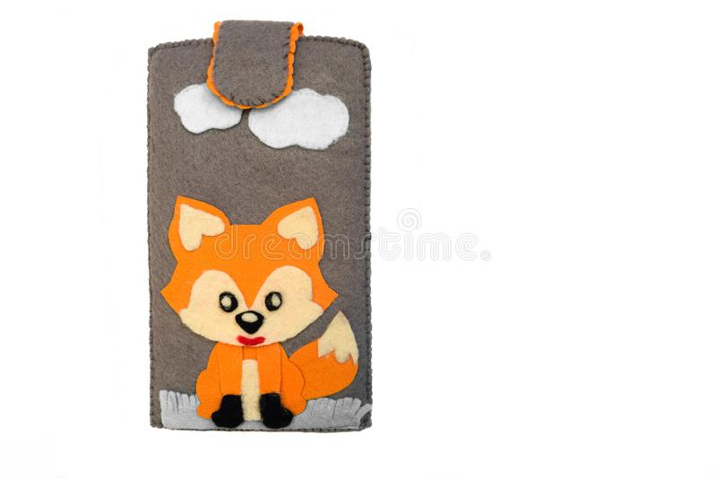 Handmade phone case made of felt. Fictional character - red fox royalty free stock photo