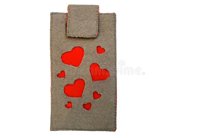 Handmade phone case made of felt with red hearts. Symbols royalty free stock photo