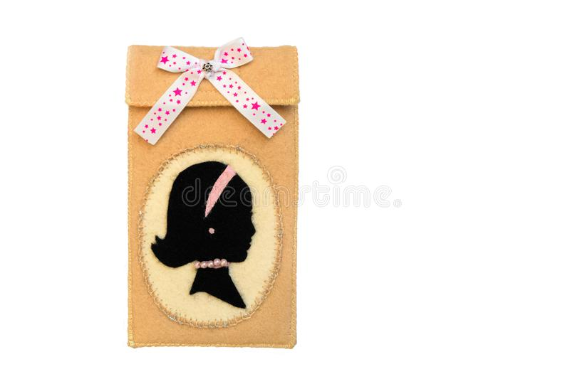 Handmade phone case made of felt. Stripe in the shape of a female head in profile stock photography