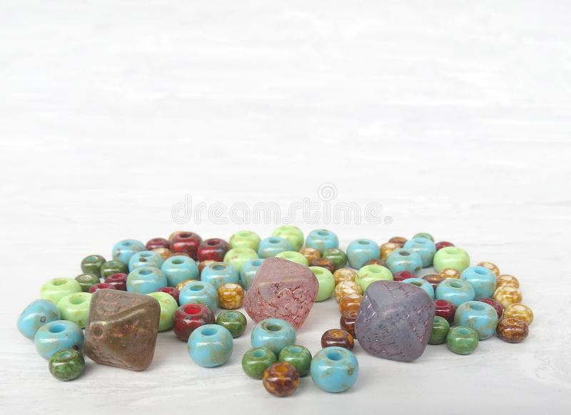 Handmade and picasso glass beads for making accessories on background. Set of beads. Handmade and picasso glass beads for making accessories on background royalty free stock photography