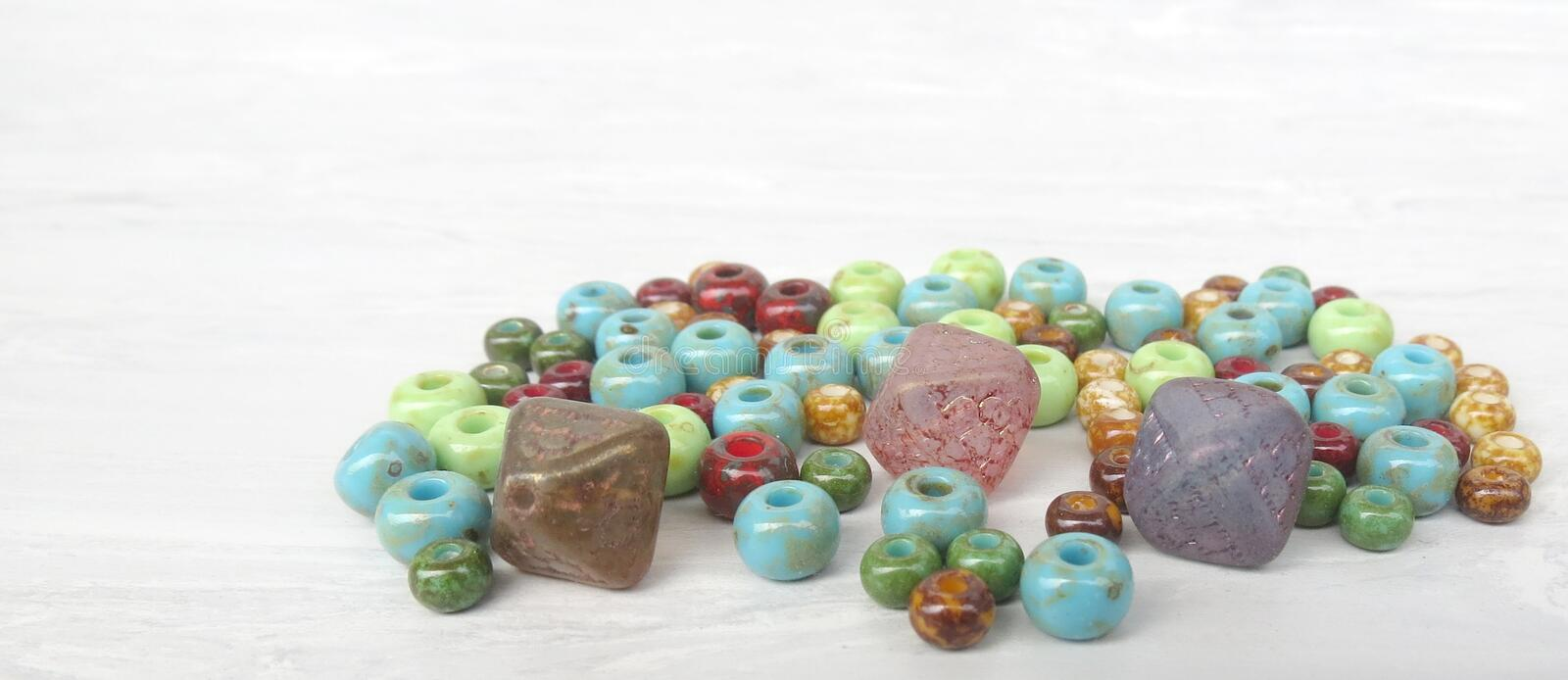 Handmade and picasso glass beads for making accessories on background. Set of beads. Handmade and picasso glass beads for making accessories on background stock photography