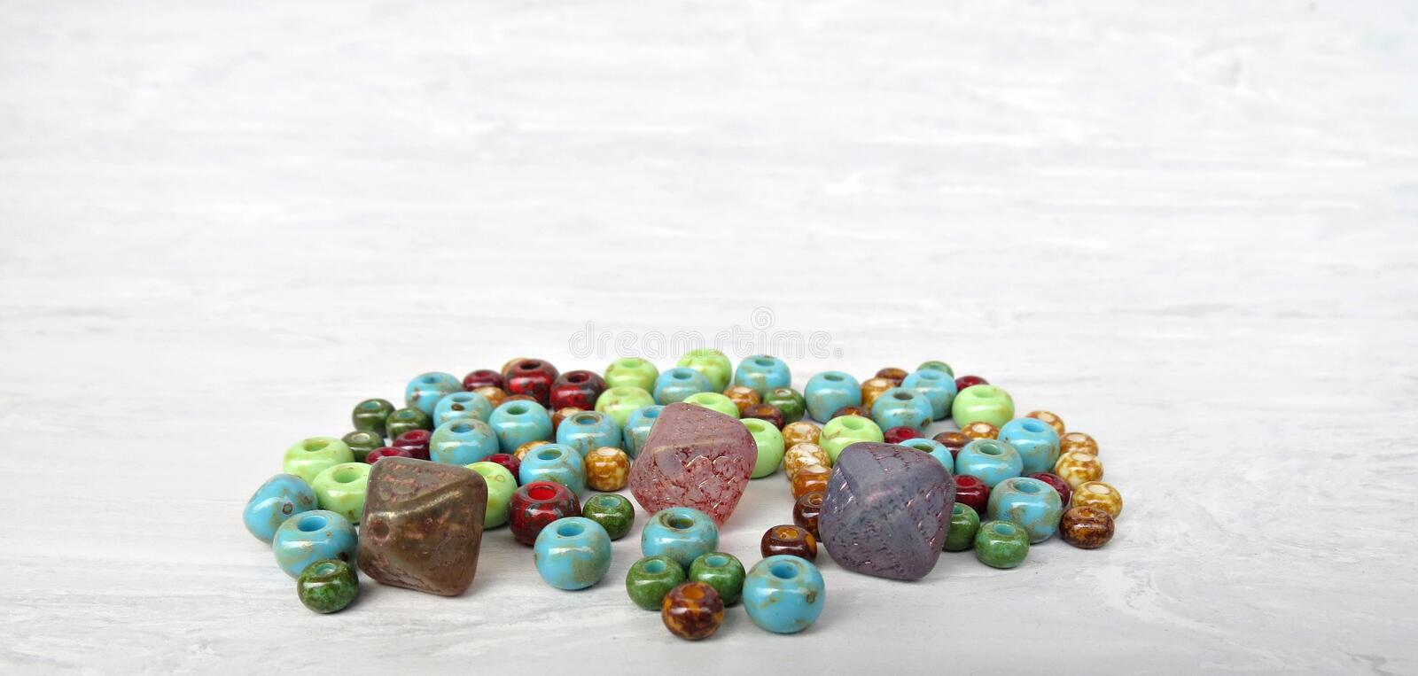 Handmade and picasso glass beads for making accessories on background. Set of beads. Handmade and picasso glass beads for making accessories on background royalty free stock photos