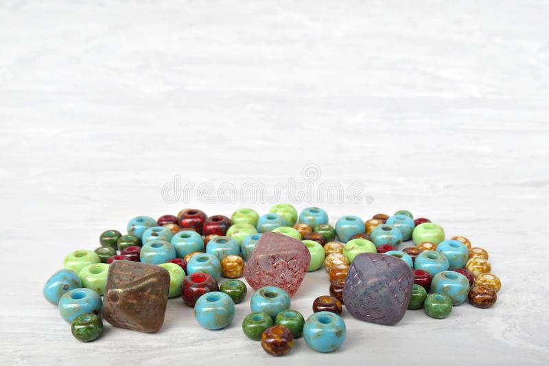 Handmade and picasso glass beads for making accessories on background. Set of beads. Handmade and picasso glass beads for making accessories on background stock photos
