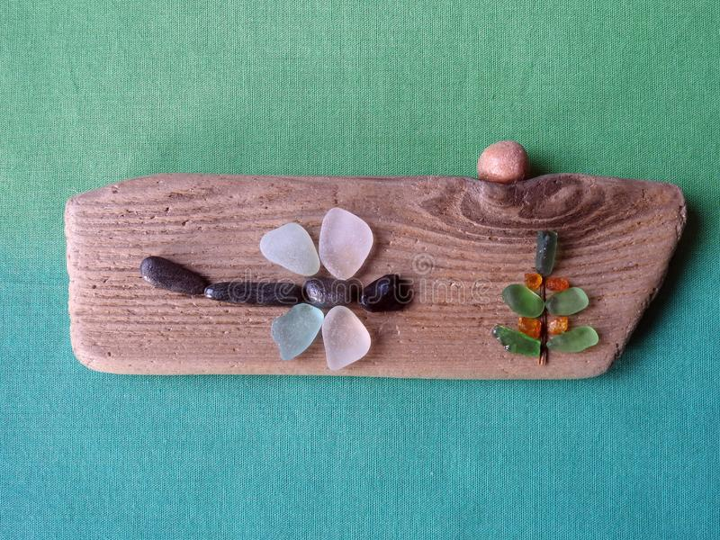 Handmade picture - Dragonfly on wooden surface, Lithuania stock images