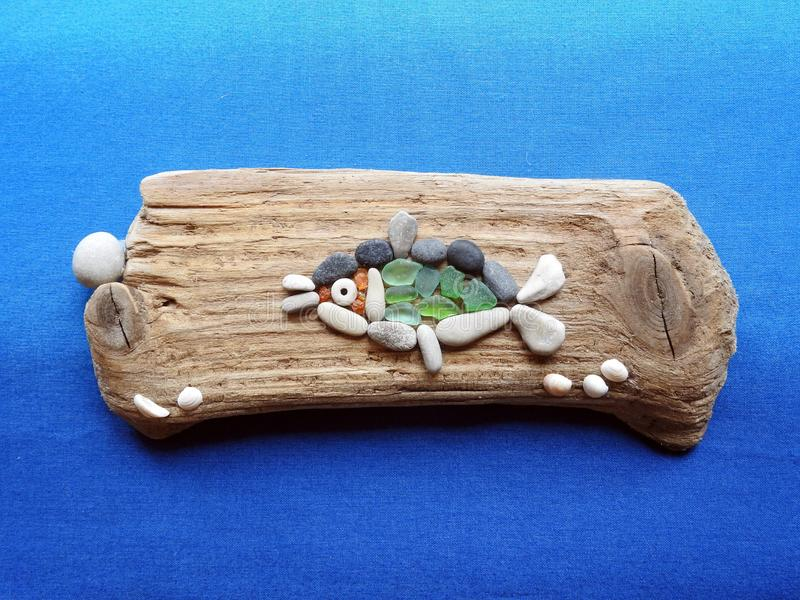 Handmade picture - fish on wooden surface, Lithuania royalty free stock image