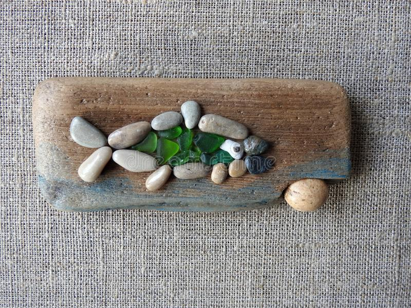 Handmade picture - fish on wooden surface, Lithuania stock image