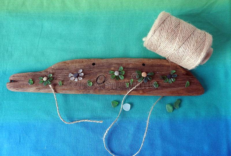 Handmade picture- flowers , using sea glass and wood, Lithuania stock photos