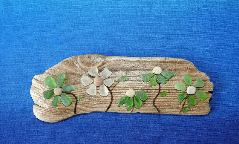 Handmade picture- flower , using sea glass and wood, Lithuania royalty free stock photos