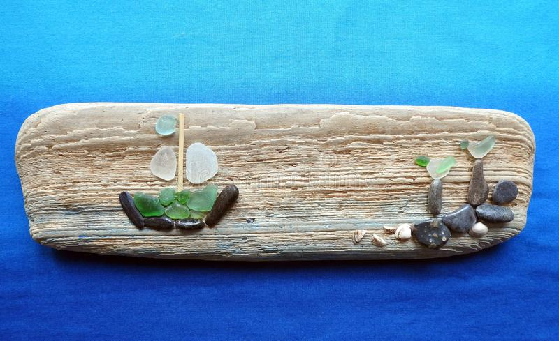 Handmade picture - ship and birds - on wooden surface, Lithuania stock image