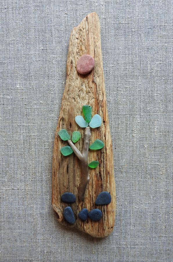 Picture done using sea glass, stones and sea wood, Lithuania royalty free stock photos
