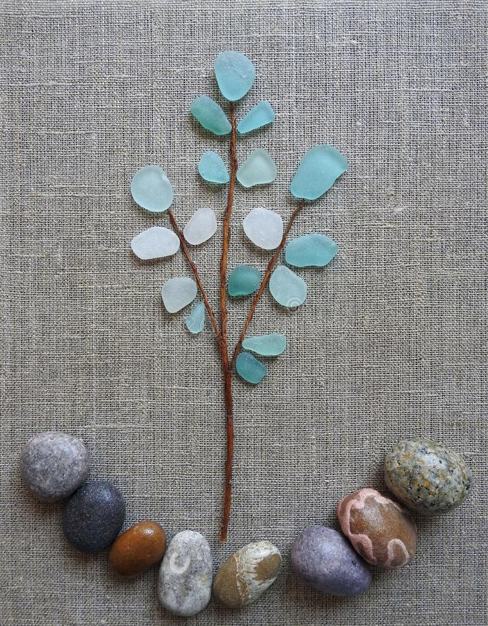Picture done using sea glass, stones and sea wood, Lithuania royalty free stock photography