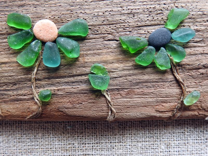 Handmade picture- flower , using sea glass and wood, Lithuania royalty free stock photo