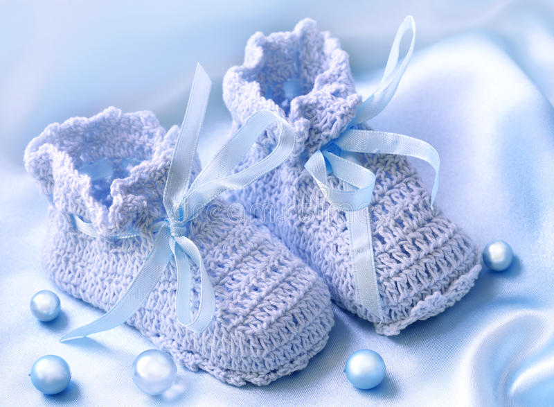 Handmade pink baby booties. With pearls royalty free stock photo