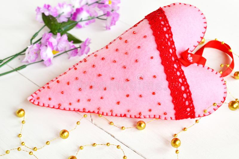 Handmade pink felt heart with beads and red lace. Valentine felt ornament. Felt hearts. Valentine Decor royalty free stock image