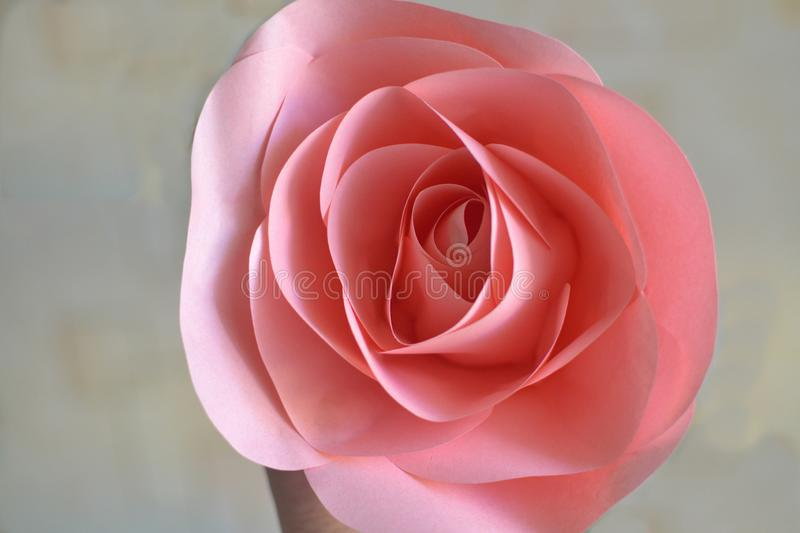 Handmade pink paper rose close-up on blurred background stock photo