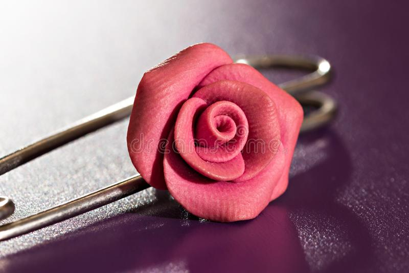 Handmade pink rose flower brooch close up stock images