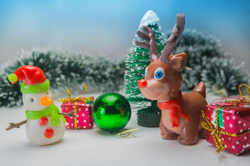 Childish plasticine reindeer and snowman stock photography