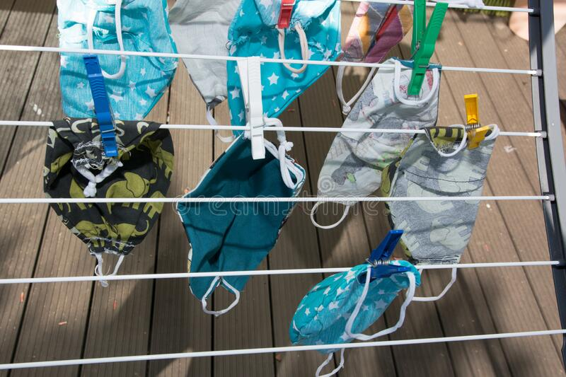 Handmade protection masks on a clothes line stock image