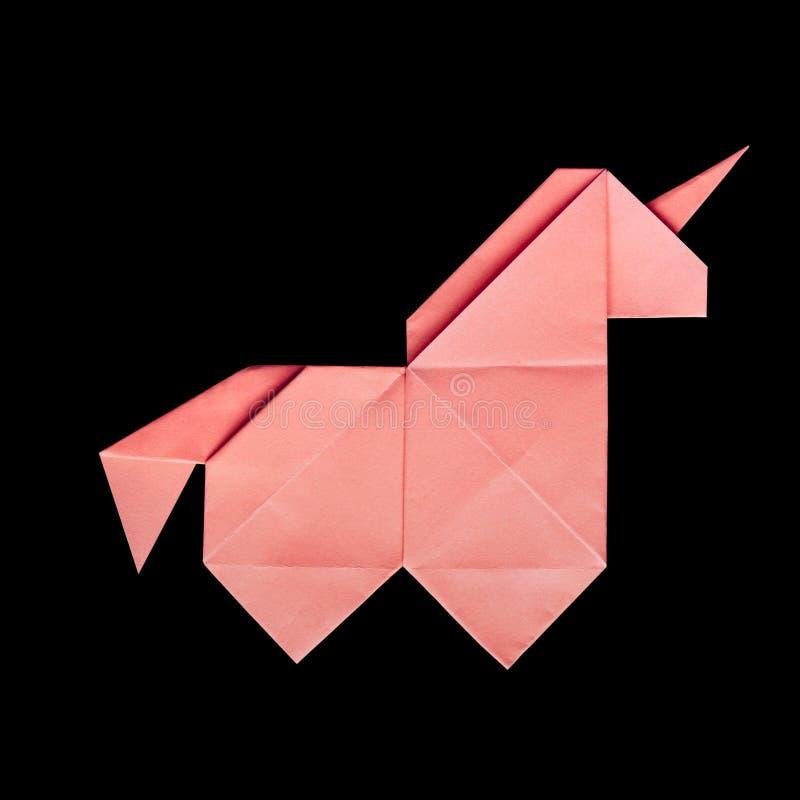Handmade różowa origami jednorożec na czarnym tle odizolowywającym obrazy royalty free