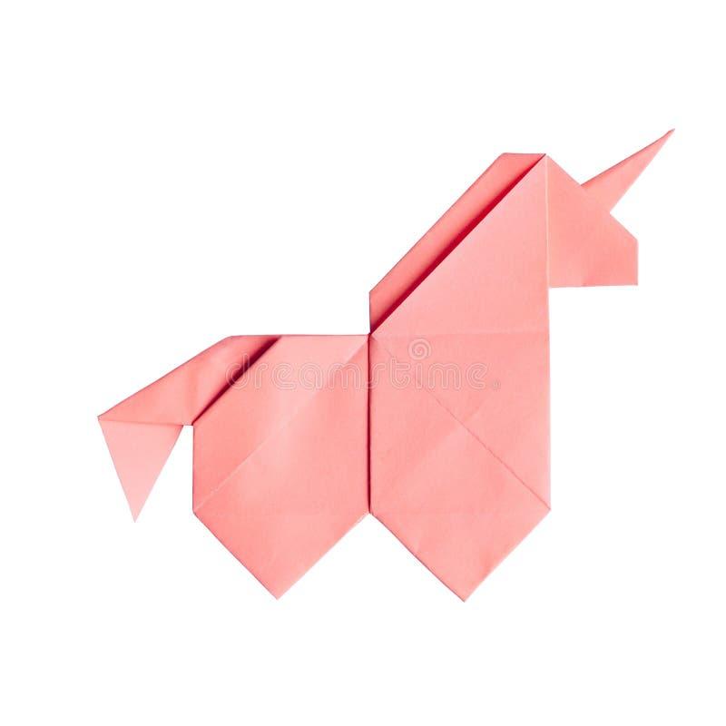 Handmade różowa origami jednorożec na czarnym tle odizolowywającym obraz stock