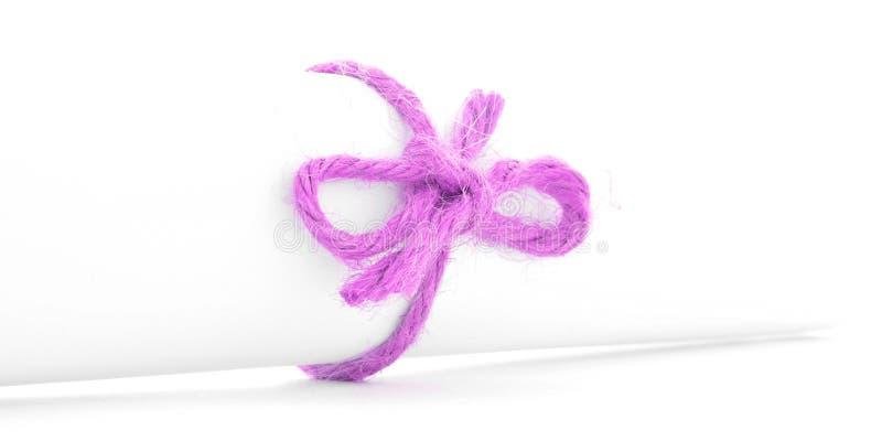 Handmade różowy linowy guzek wiązał na bielu listu ślimacznicie odizolowywającej zdjęcia stock