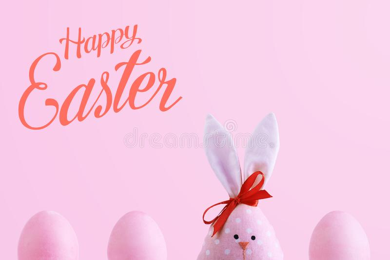 Handmade rabbit among Easter eggs, concept of celebration and fun. Text, happy easter stock images