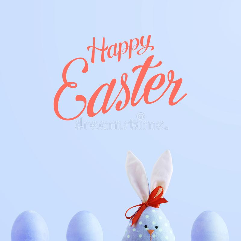 Handmade rabbit among Easter eggs, concept of celebration and fun. Text, happy easter stock photos