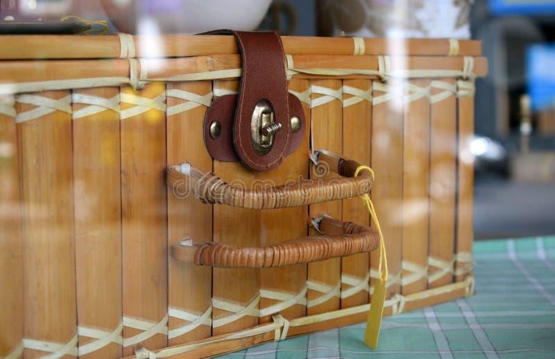 Handmade rectangular honey rattan wicker storage vintage basket on window display. stock photo