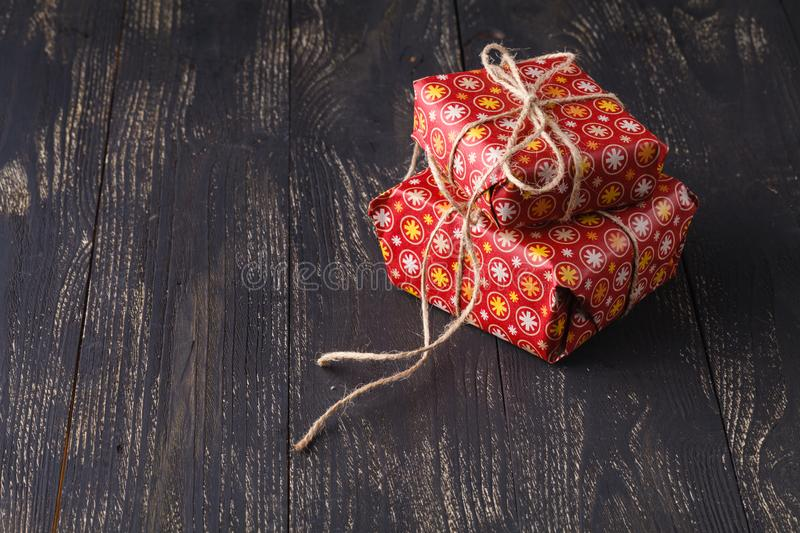 Handmade red gift box with bow on the wood old table. stock photos