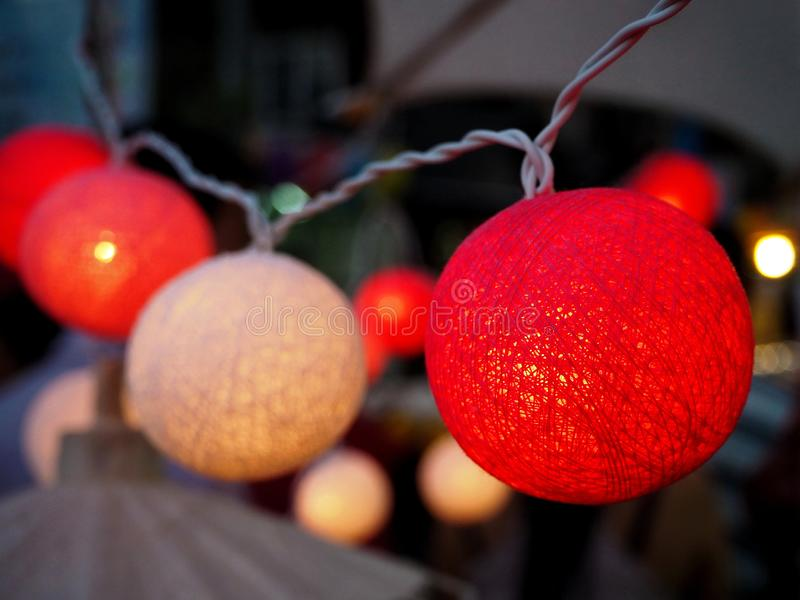 Handmade Red and White Cotton Ball String Lights stock image