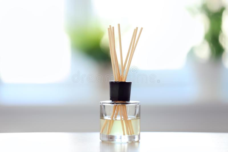 Handmade reed freshener on table. Against blurred background royalty free stock photo