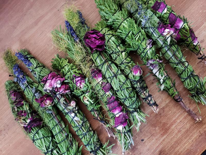 Handmade smudge wands. Rosemary, witchy, magic, roses, lavender stock photos
